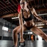 sports-women-model-portrait-sportswear-tanned-gyms-fitness-model-thong-sports-bra-belly-bodybuilding-clothing-supermodel-structure-Dani-Dikeman-leg-muscle-photo-shoot-sport-venue-undergarment-2